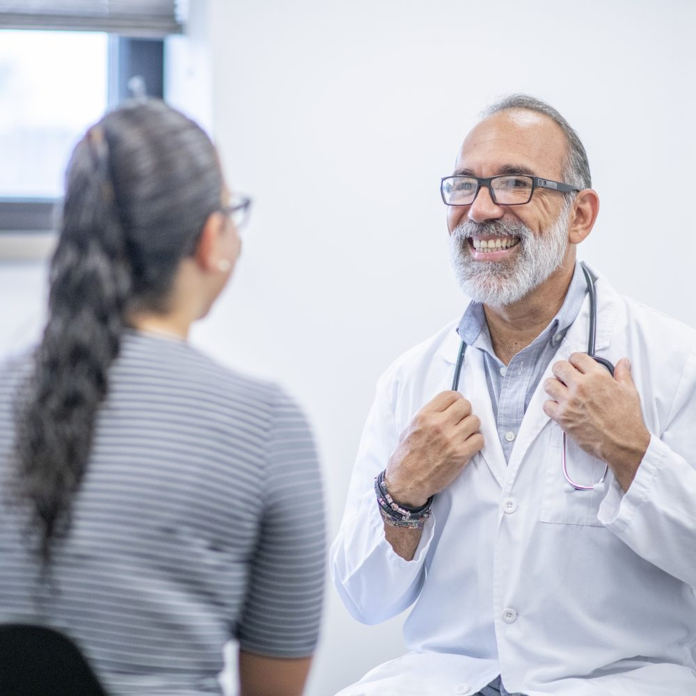 Male Doctor Meets With Female Patient