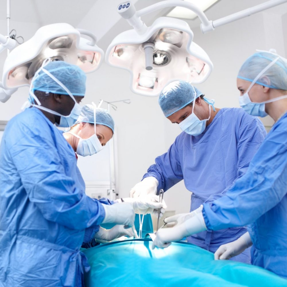 Medical surgeons performing surgery in an operating theatre together